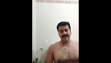 Indian daddy in bathroom with his gf on cam while wife is in bedroom