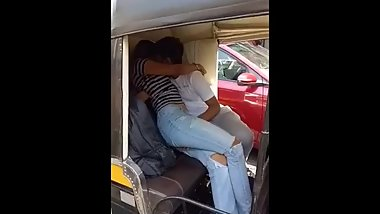 Indian teen age boy and girl kissing in public in Mumbai