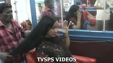 Indian young women shaves her waist length hair